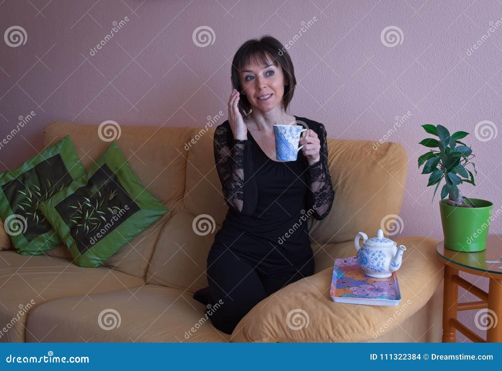 Happy mature woman in black shirt.