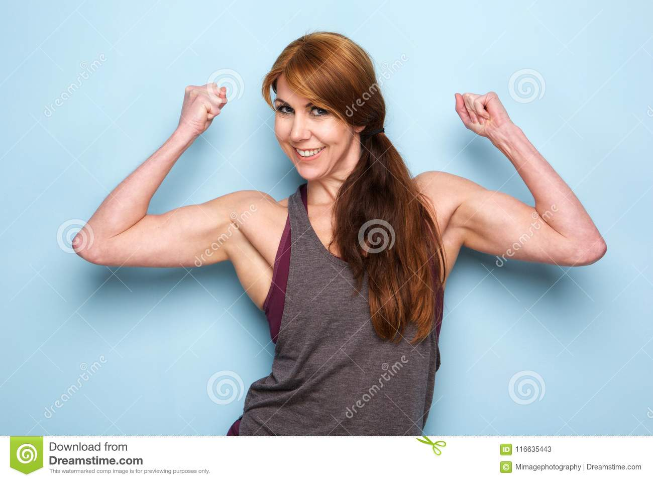 Happy Mature Woman Flexing Bicep Muscles Stock Image Image Of