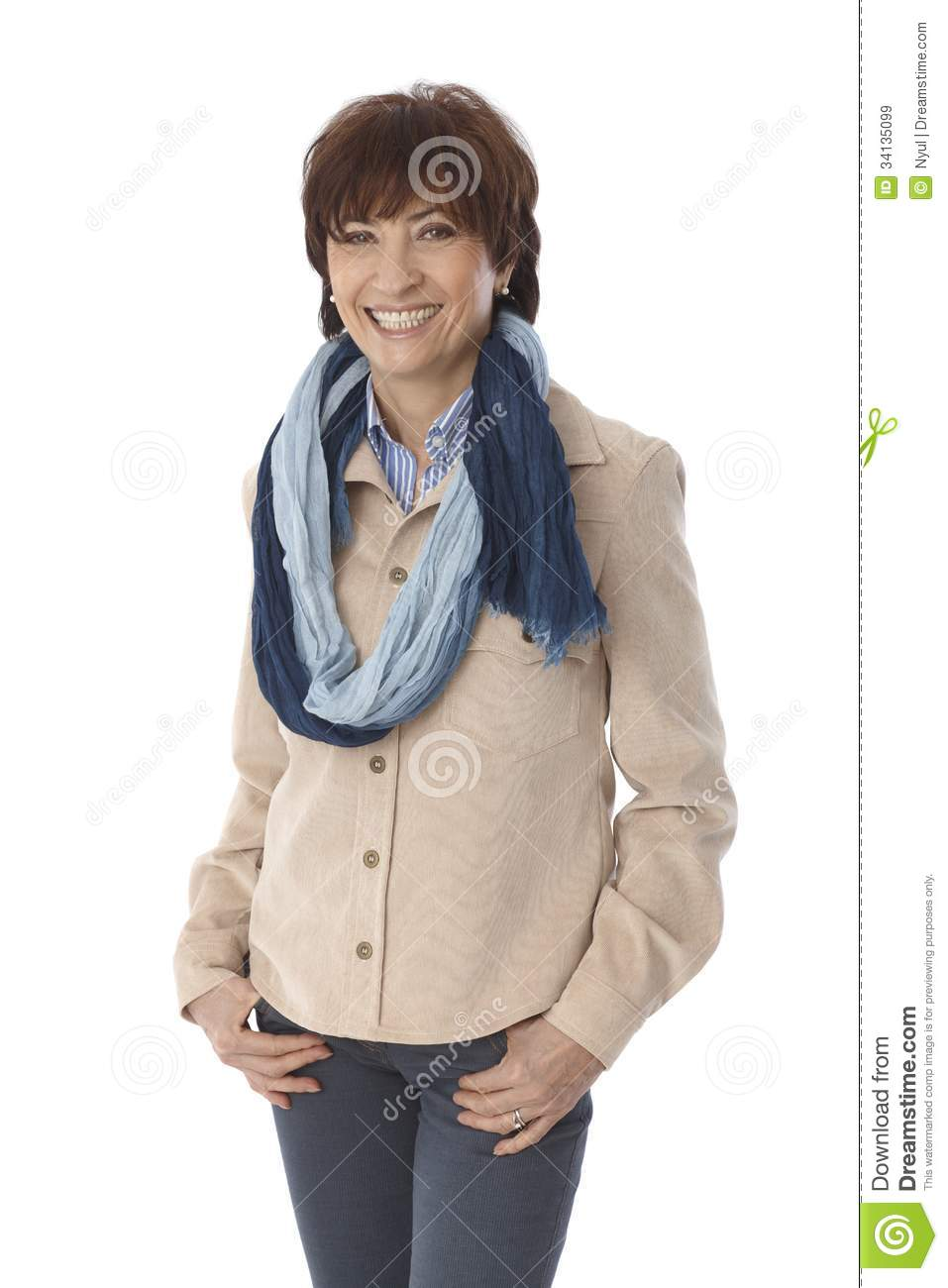 Portrait of happy mature woman in casual clothes smiling with hands in