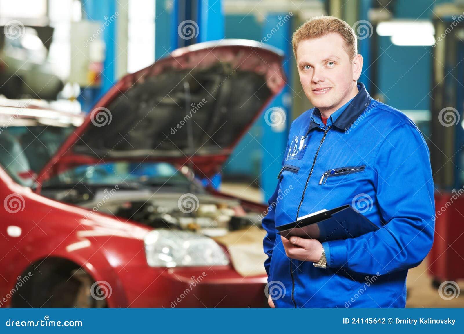 happy maintenance engineers looking away in automobile repair shop royalty free stock image. Black Bedroom Furniture Sets. Home Design Ideas