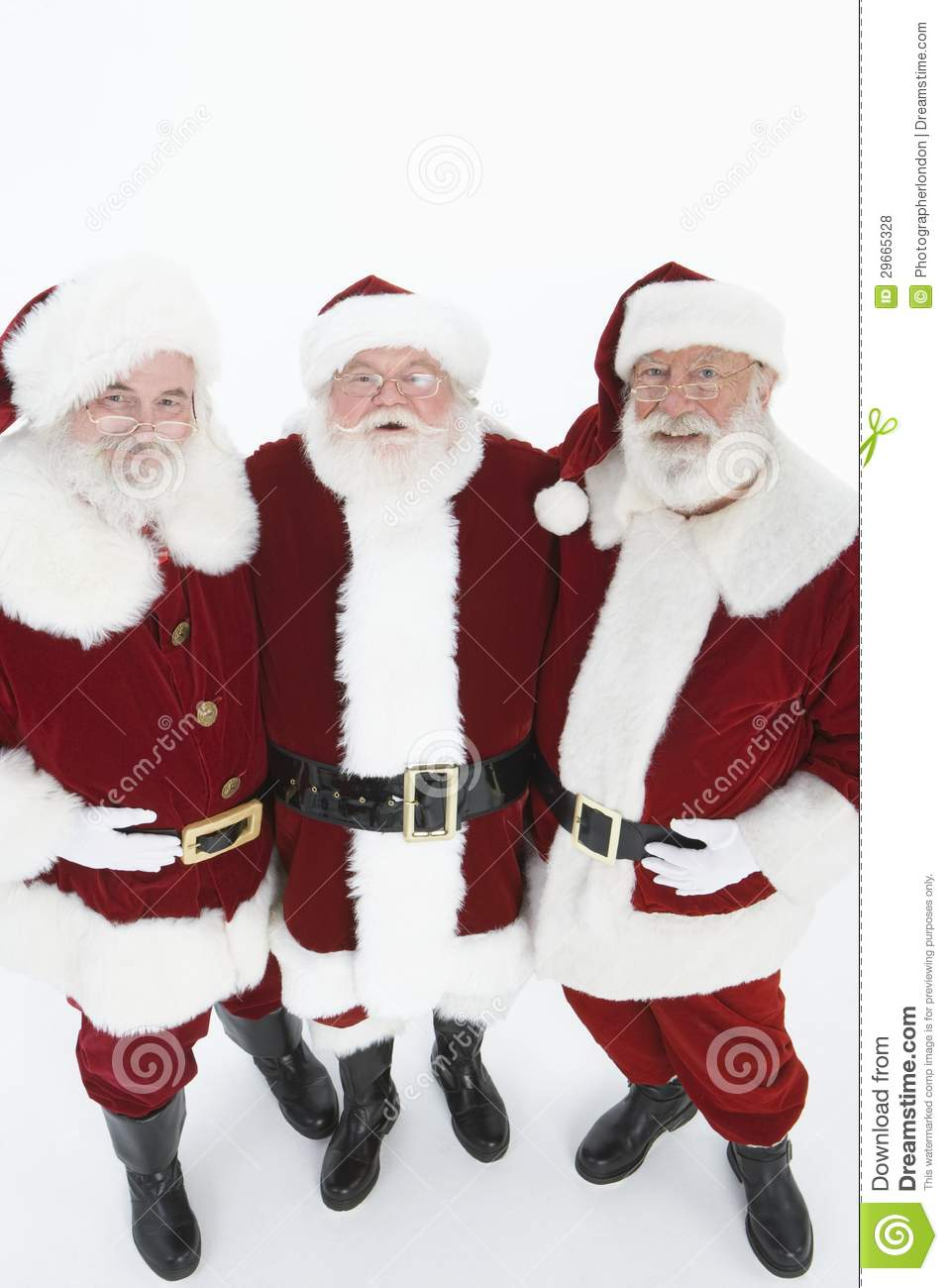 happy men in santa claus standing together royalty free