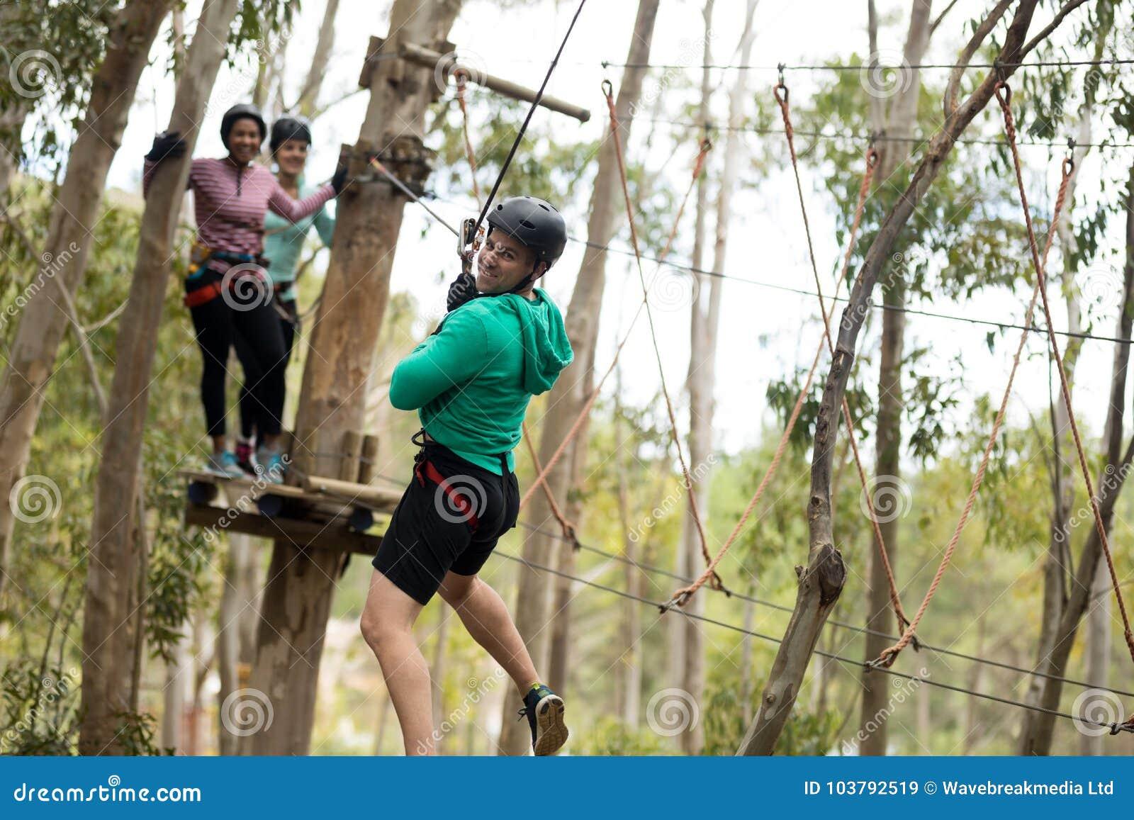Man On Zipline In Adventure Park Stock Image Image Of Hanging Line 103792519