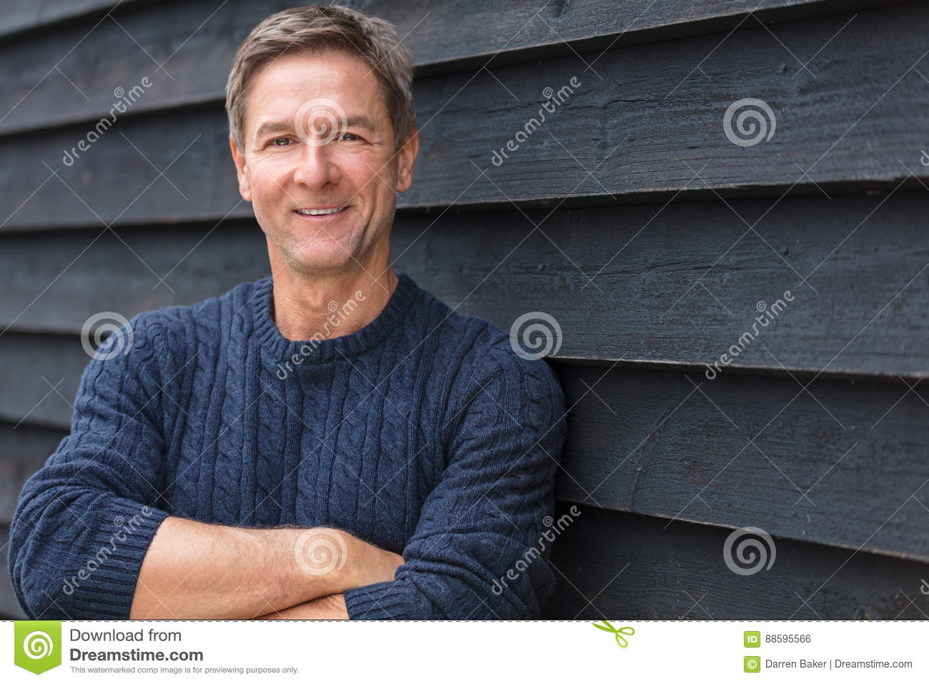Happy Middle Aged Man Arms Folded