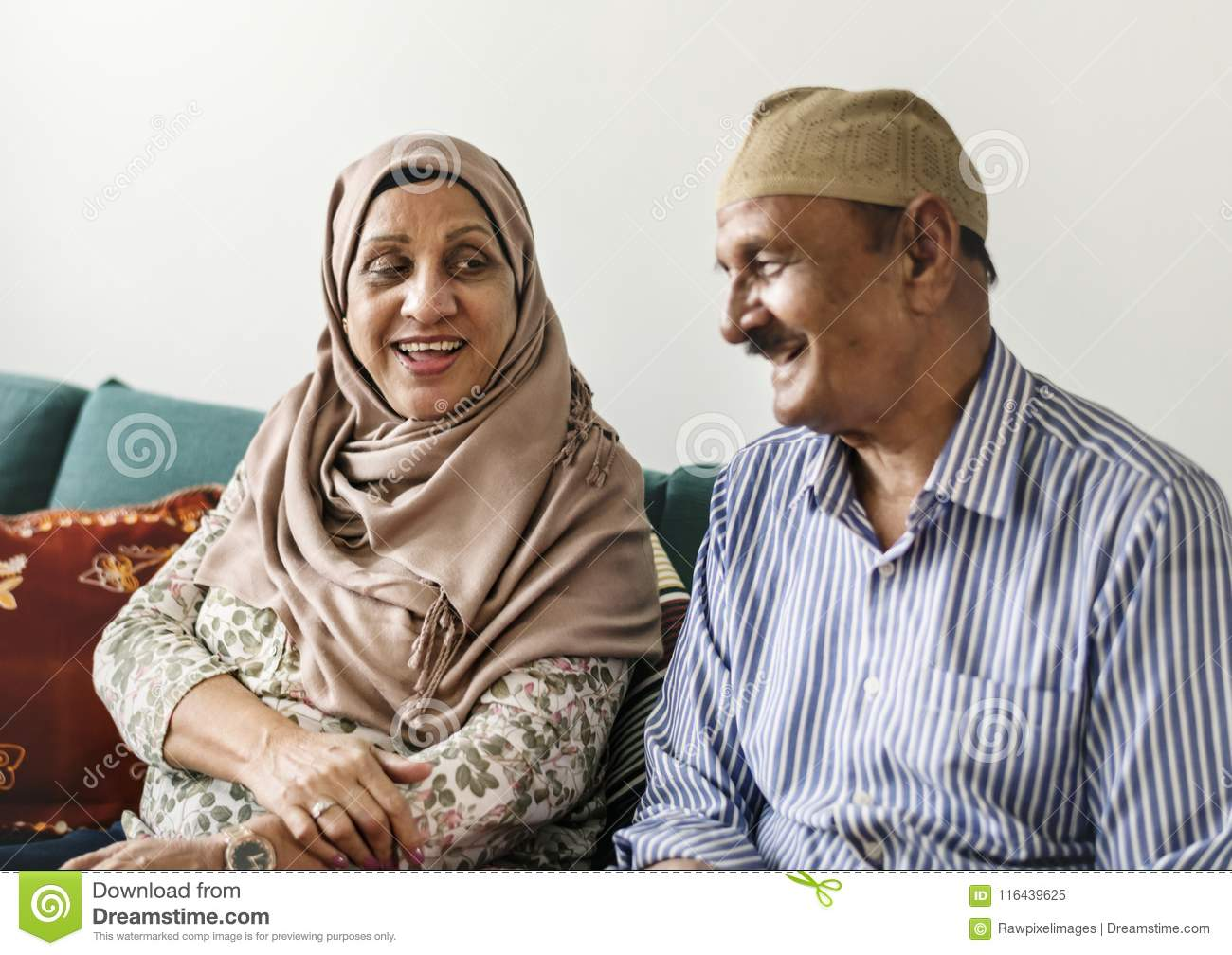 Happy Middle Eastern mature couple at home