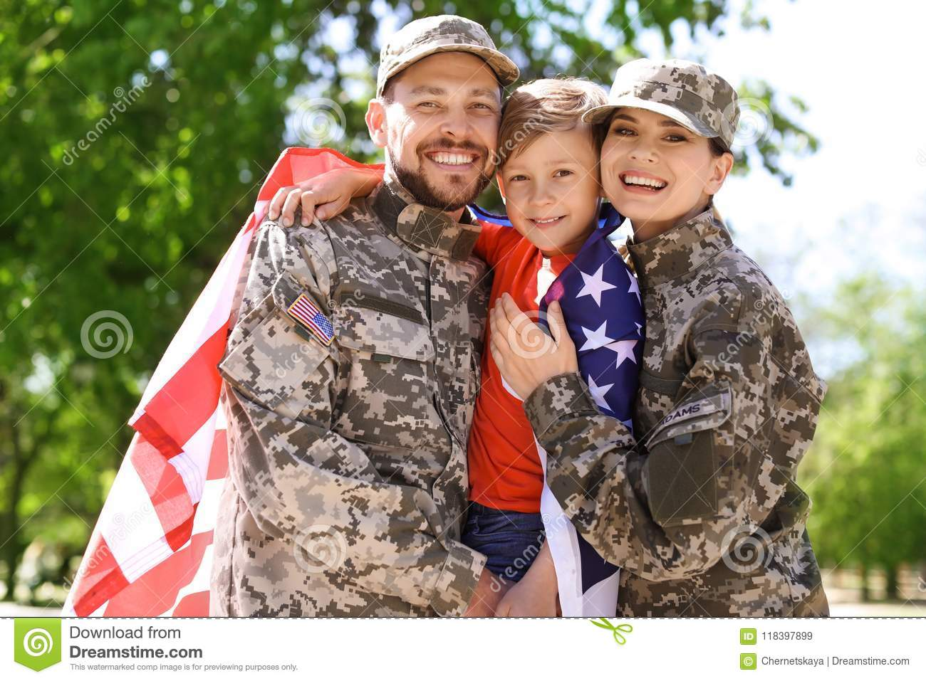 Happy military family with their son, outdoors
