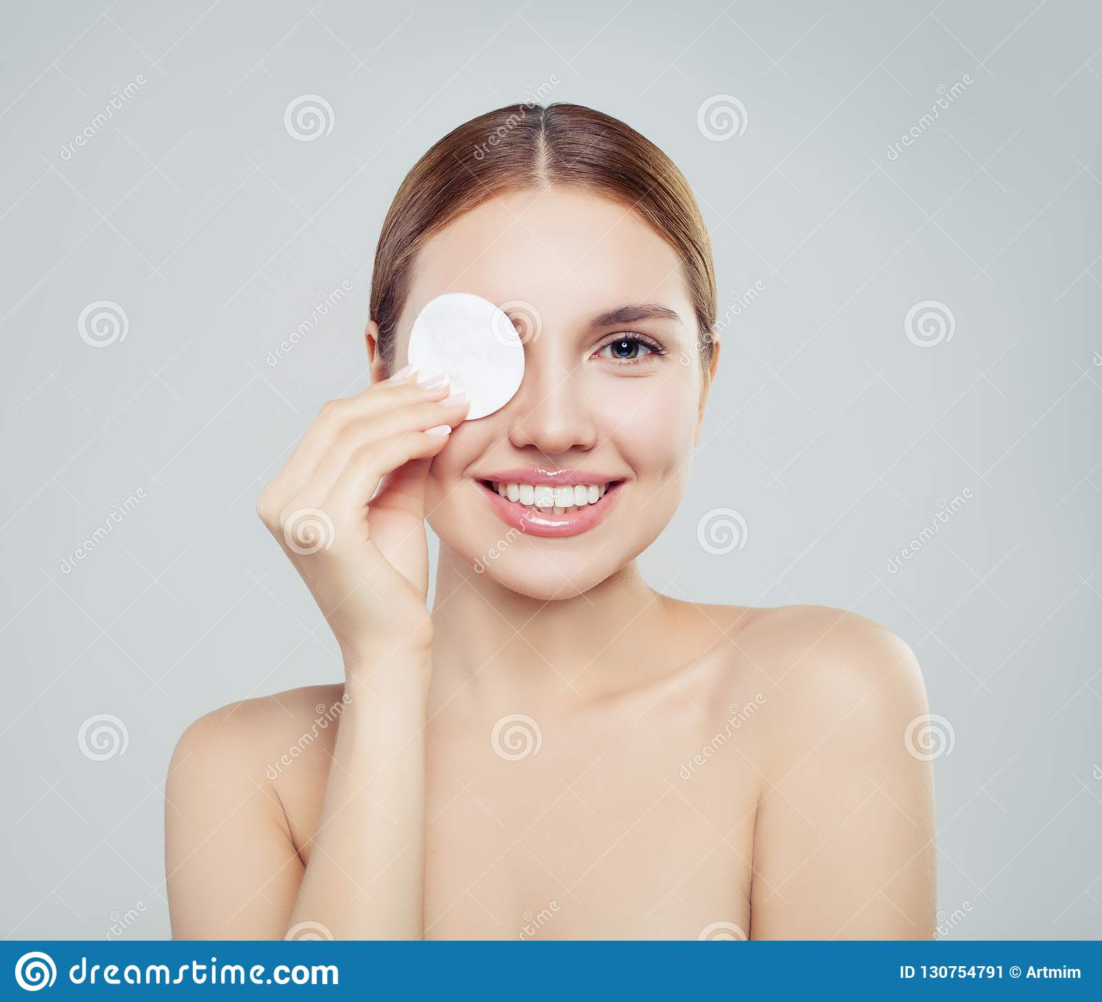 Happy model woman with cotton pads. Skincare, facial treatment,