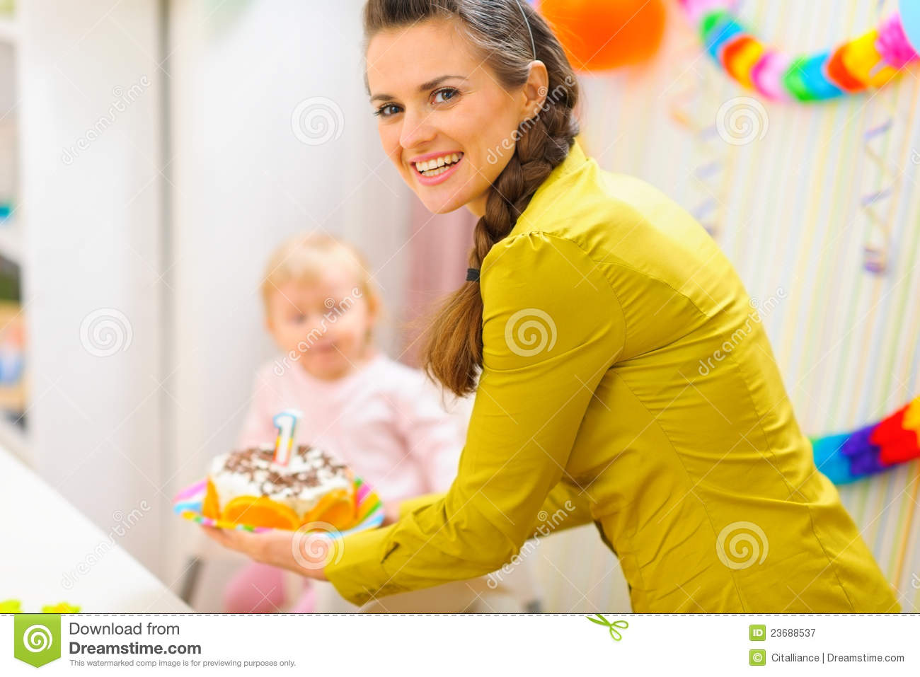 Happy Mom Carries Birthday Cake For Baby Royalty Free
