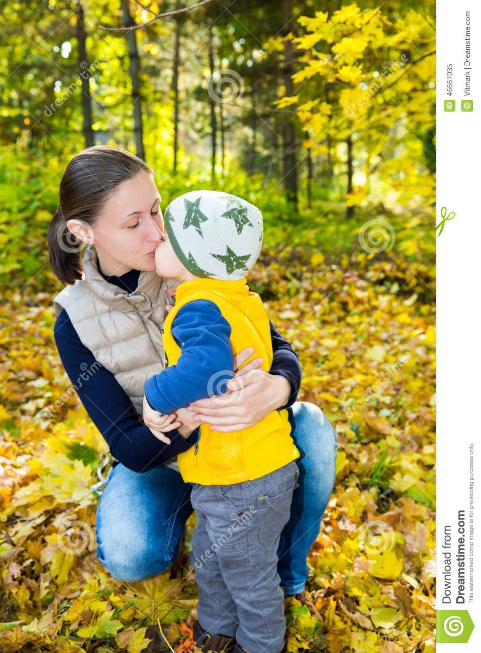 Happy Mom And Child Boy Hugging On Nature At Fall. Stock ...