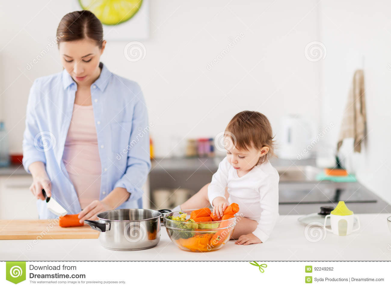 Home Kitchen Cooking happy mother and baby cooking food at home kitchen stock photo