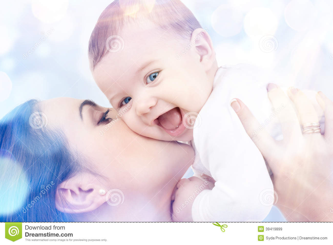 Happy mother with baby in hands