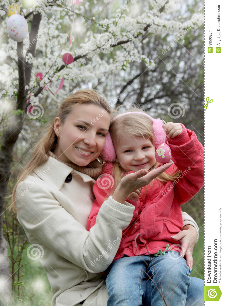 Happy mother and child with Easter eggs
