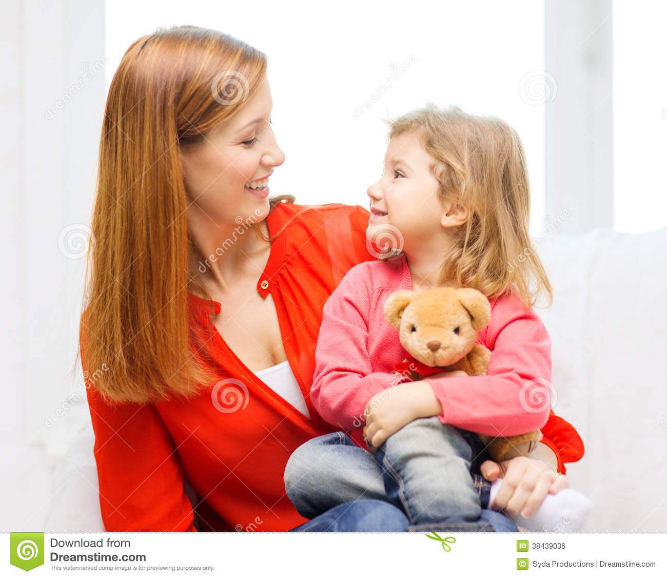 Happy Mother And Child With Teddy Bear At Home Stock Photo