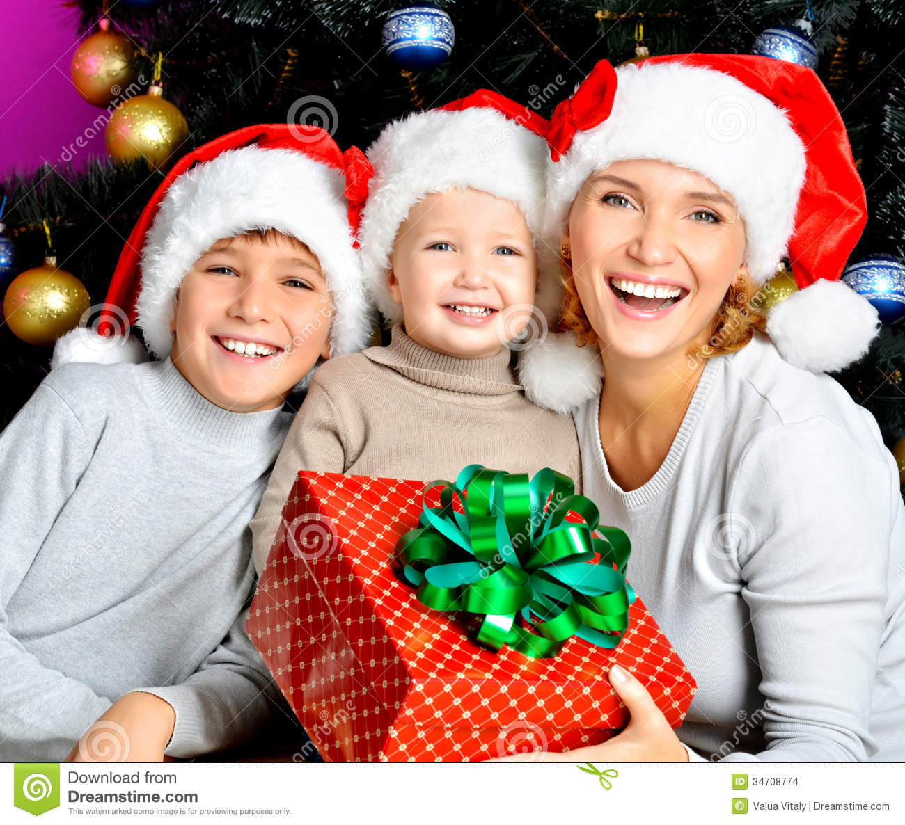 Happy Mother With Children Holds The New Year Gift Stock ...
