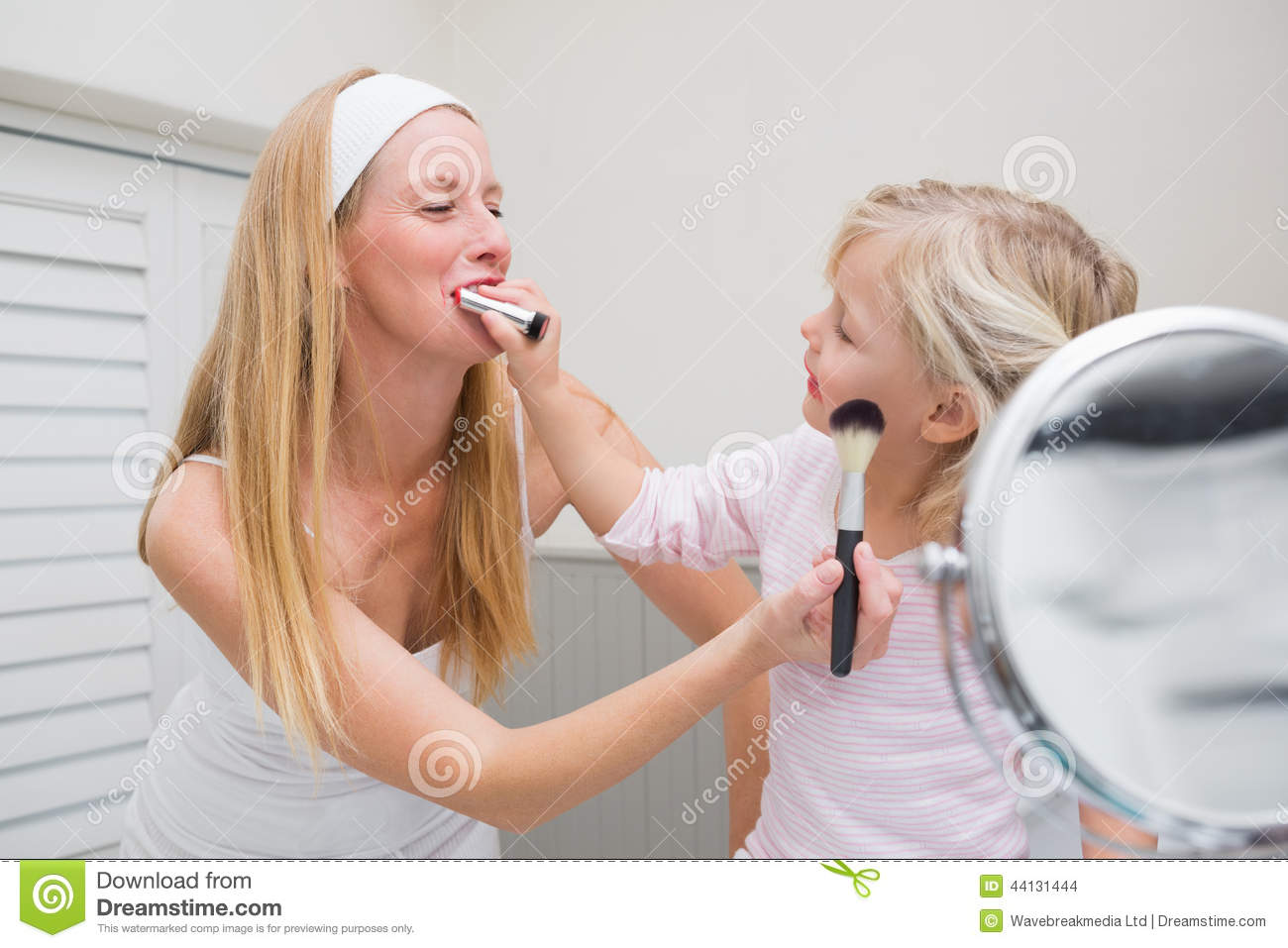 Happy Mother And Daughter Playing With Make Up Stock Photo