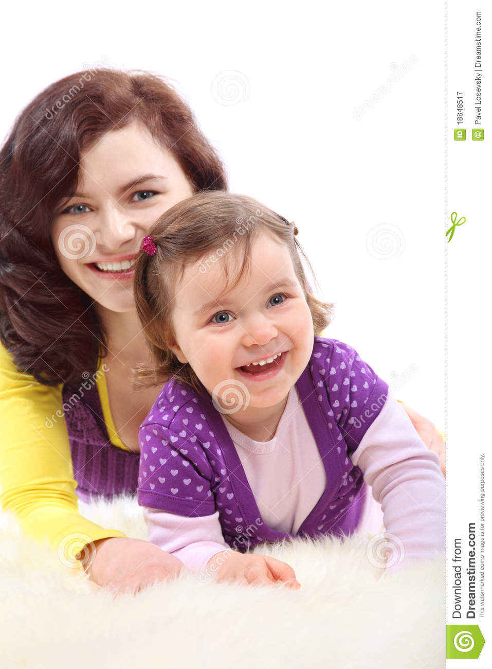 Happy mother embraces her laughing daughter