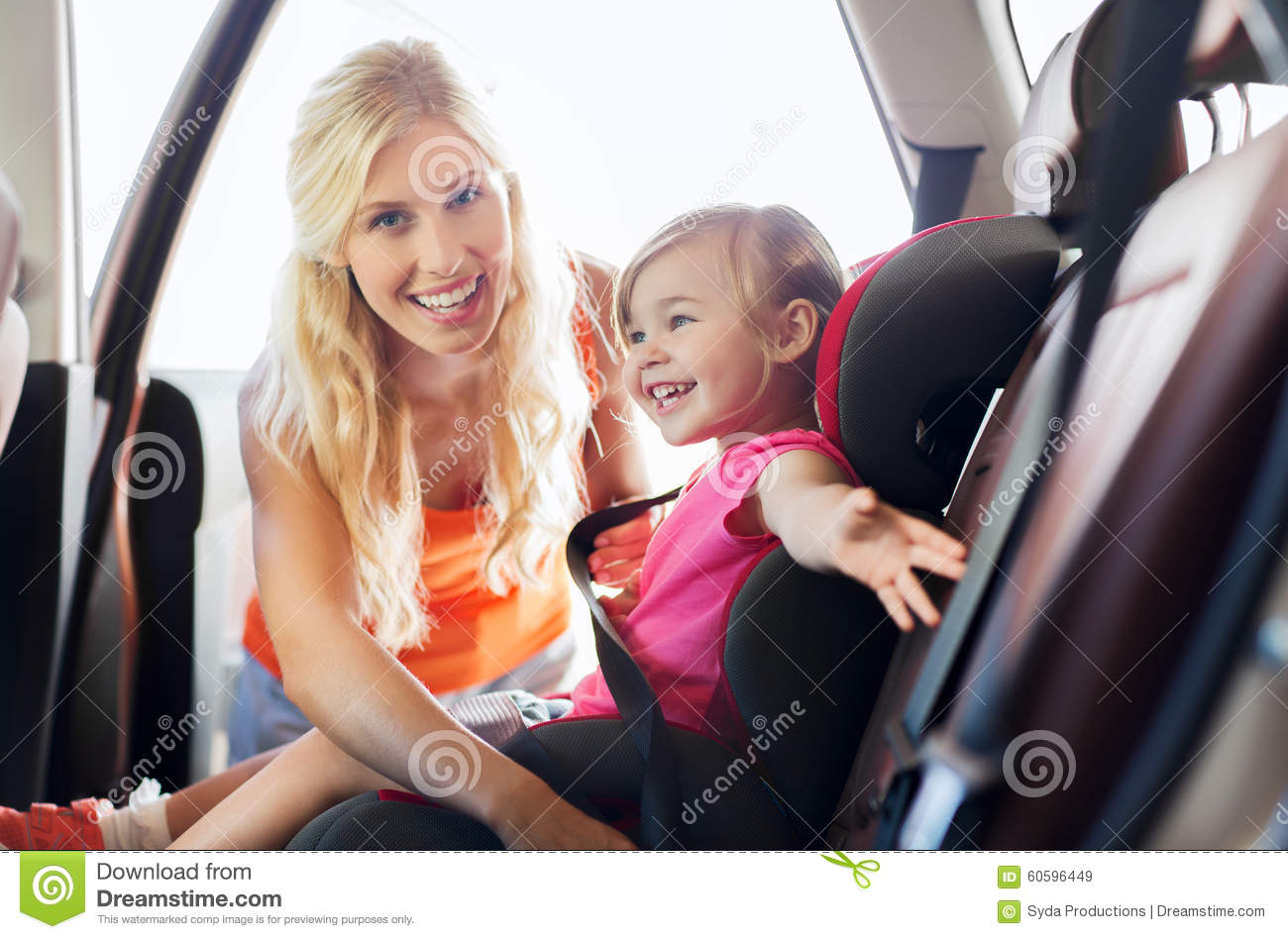 happy mother fastening child with car seat belt stock image image of daughter person 60596449. Black Bedroom Furniture Sets. Home Design Ideas