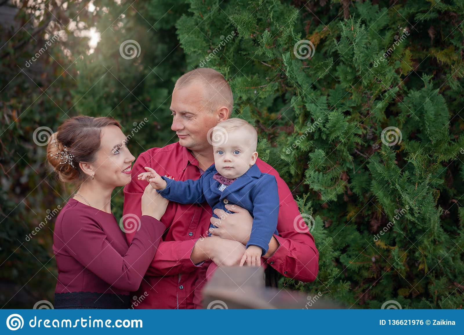 Happy mother, father and son in the park. Happiness in family life in summer day