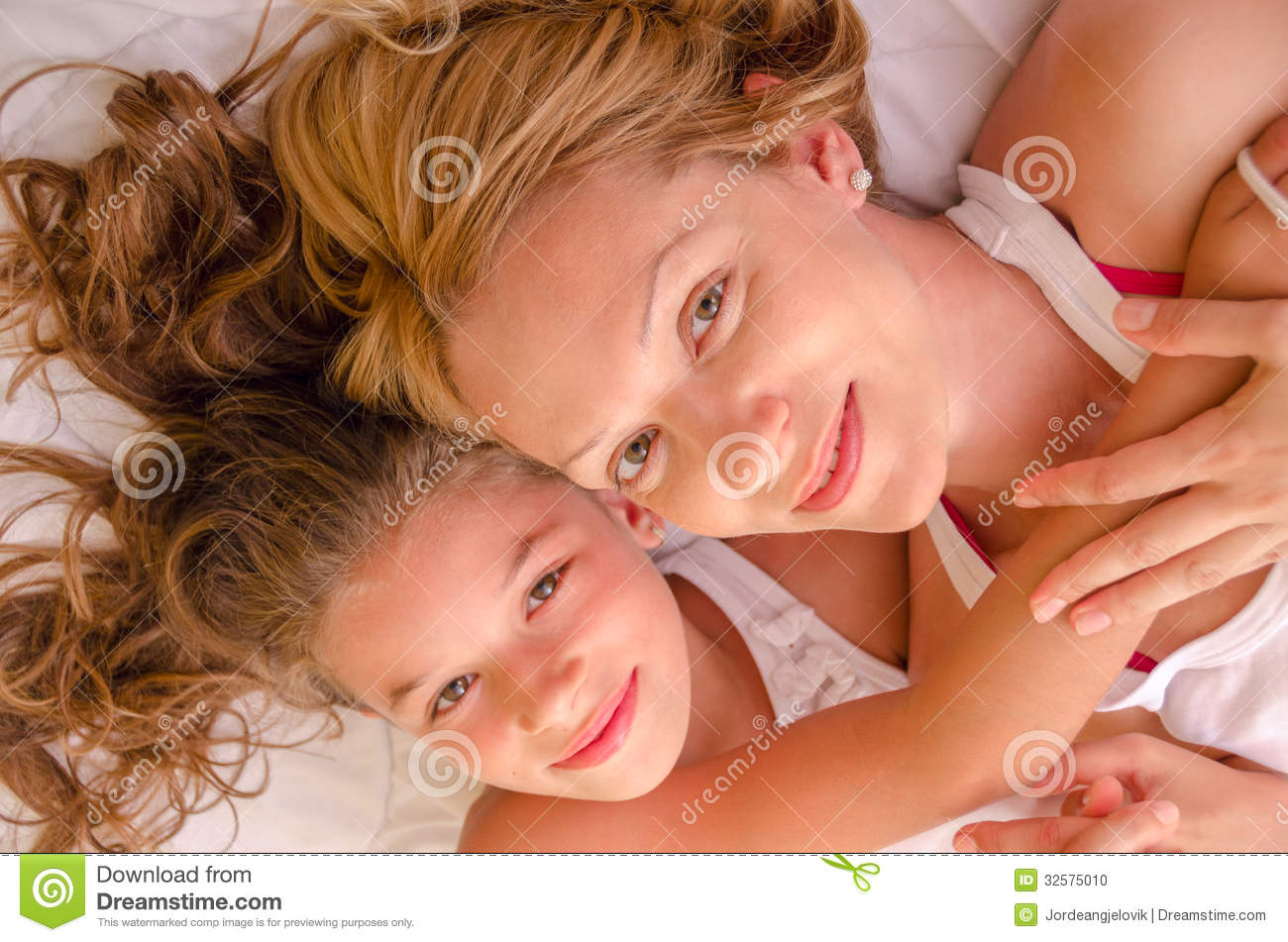happy mother and girl laying in bed stock photo image 32575010. Black Bedroom Furniture Sets. Home Design Ideas