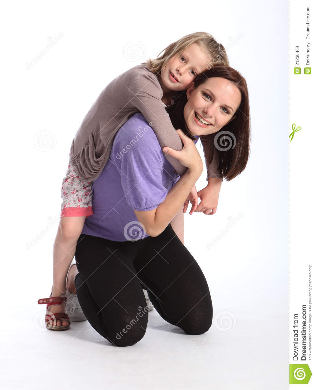 Happy Mother Giving Daughter Fun Piggy Back Ride Stock