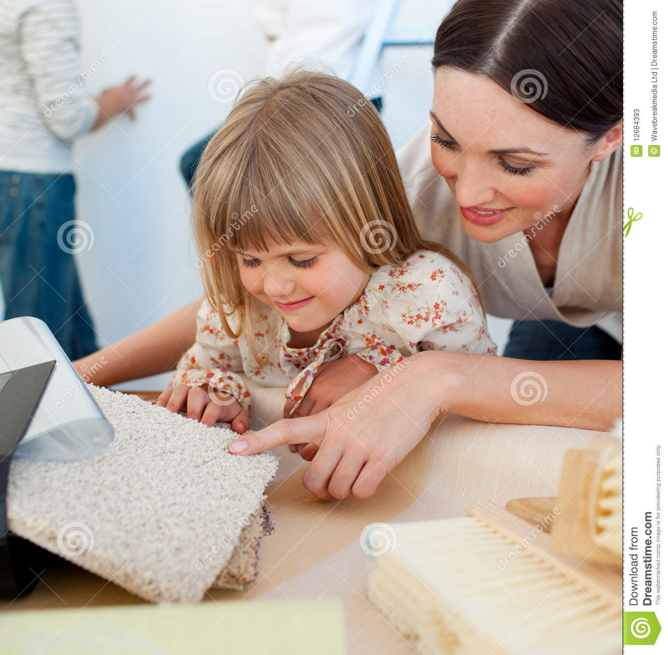 Happy Mother And Her Daughter Decorating A Room Stock