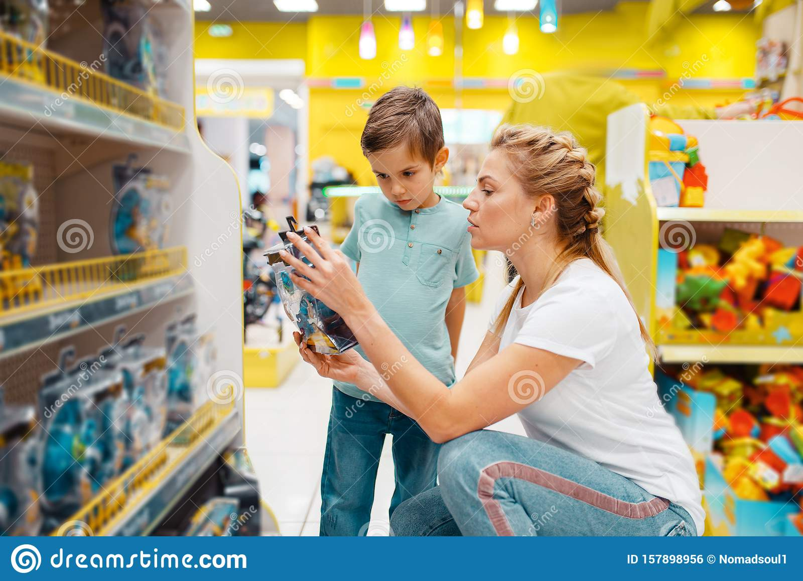Happy Mother With Her Little Son In Kids Store Stock Photo Image Of Choice Indoor 157898956