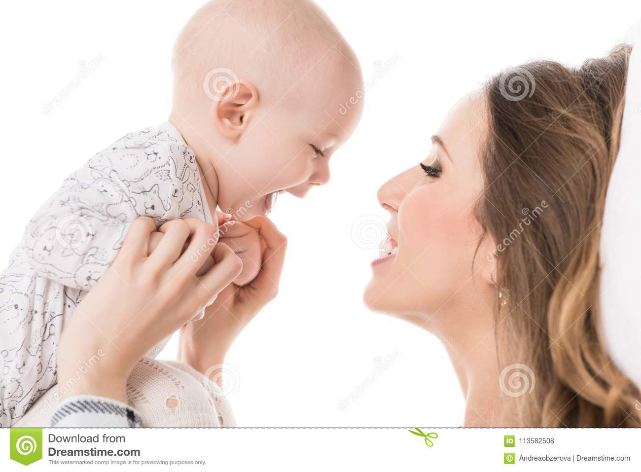 Happy mother hugging her adorable baby son. Happy family. Mother and newborn child portrait.
