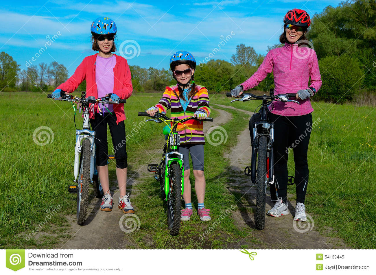 Happy Mother And Kids On Bikes Cycling Outdoors Stock