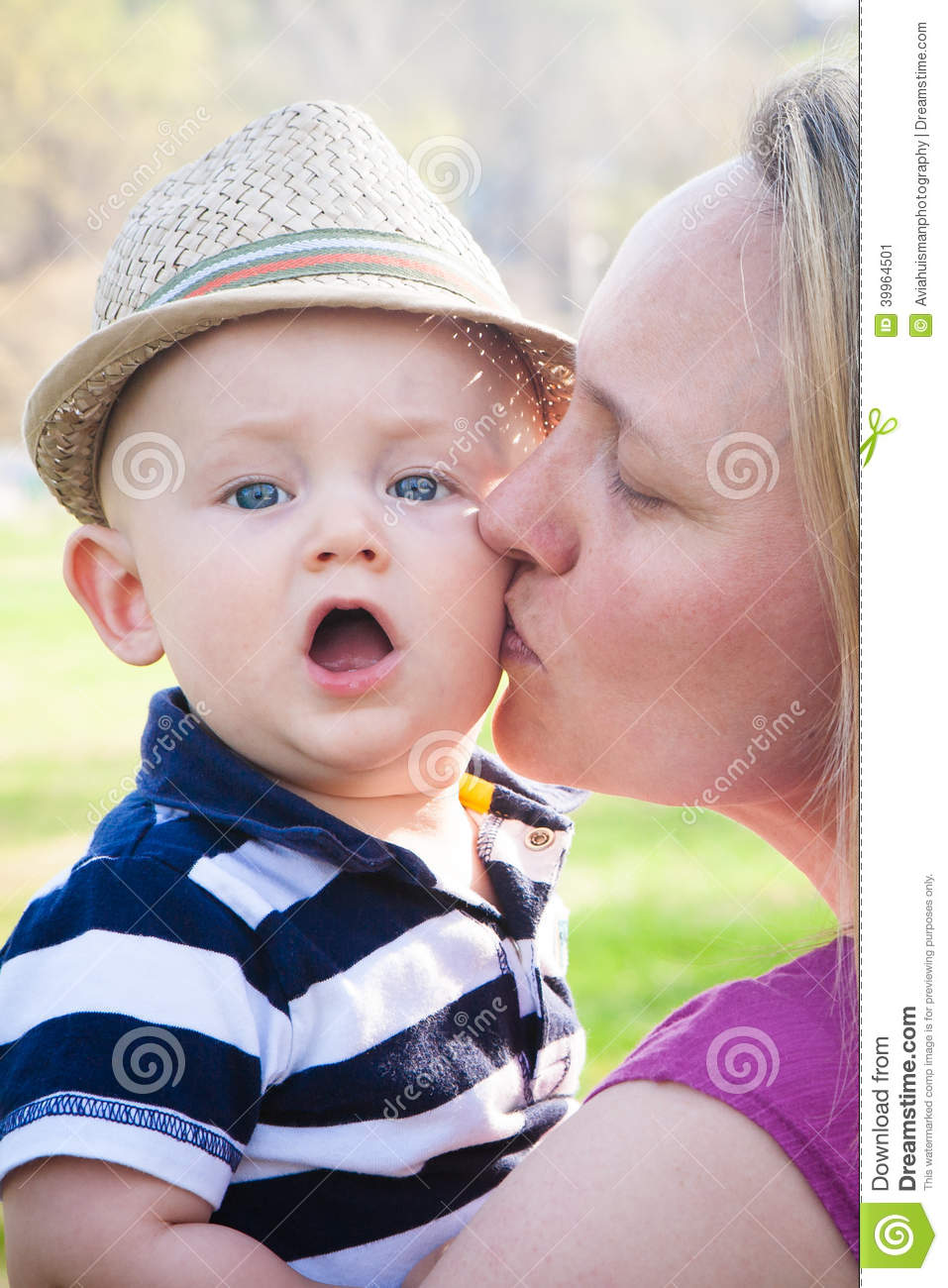 happy mother kissing cute baby boy stock image - image of kissing