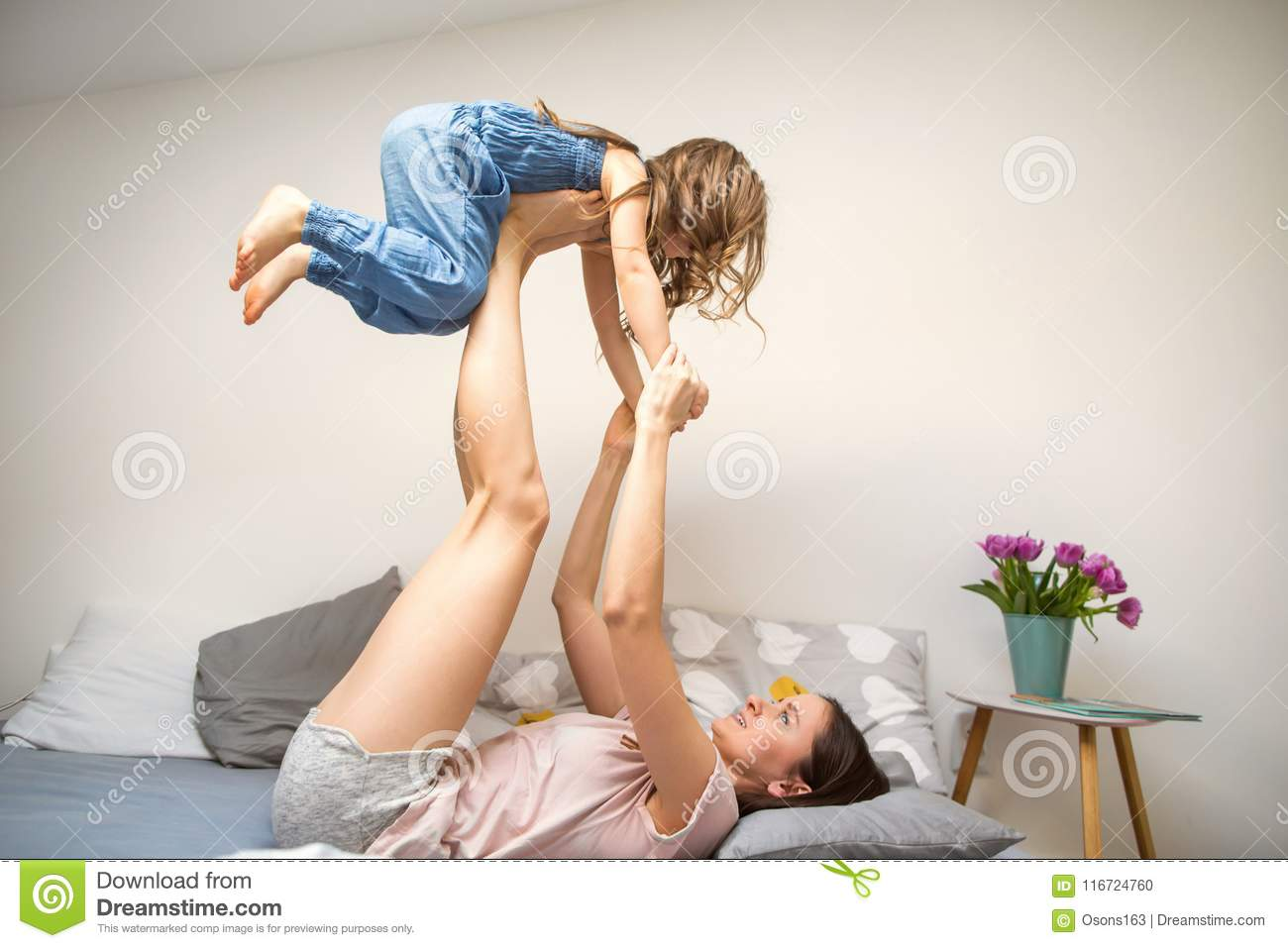 Happy mother playing with her daughter at home, mother`s day