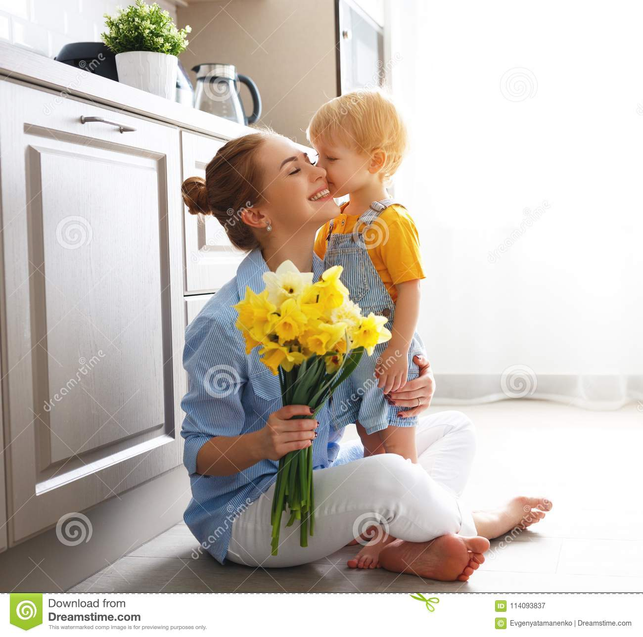 Happy mother`s day! baby son gives flowersfor mother on holiday