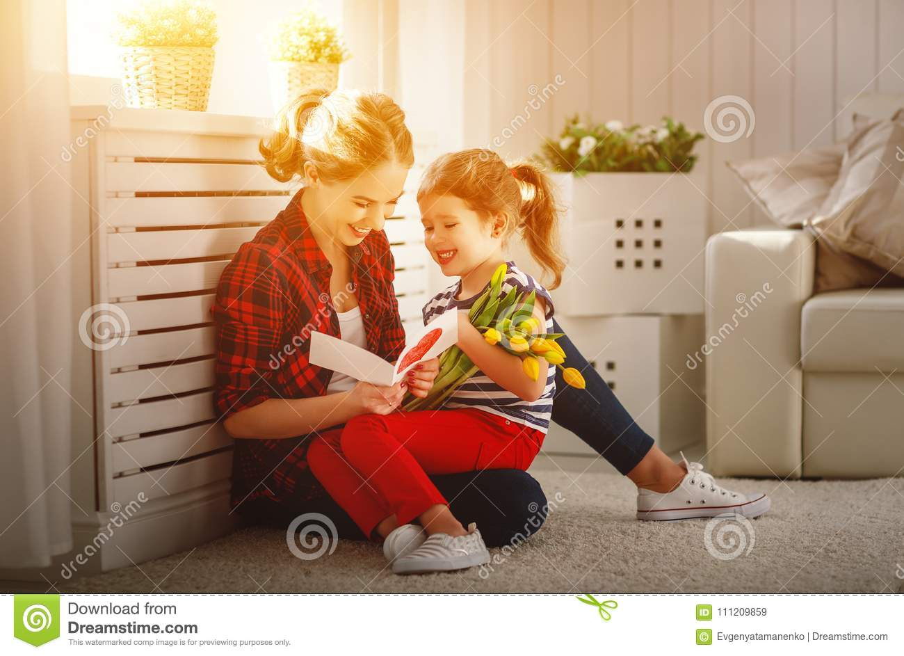 Happy mother`s day! Child daughter congratulates moms and gives