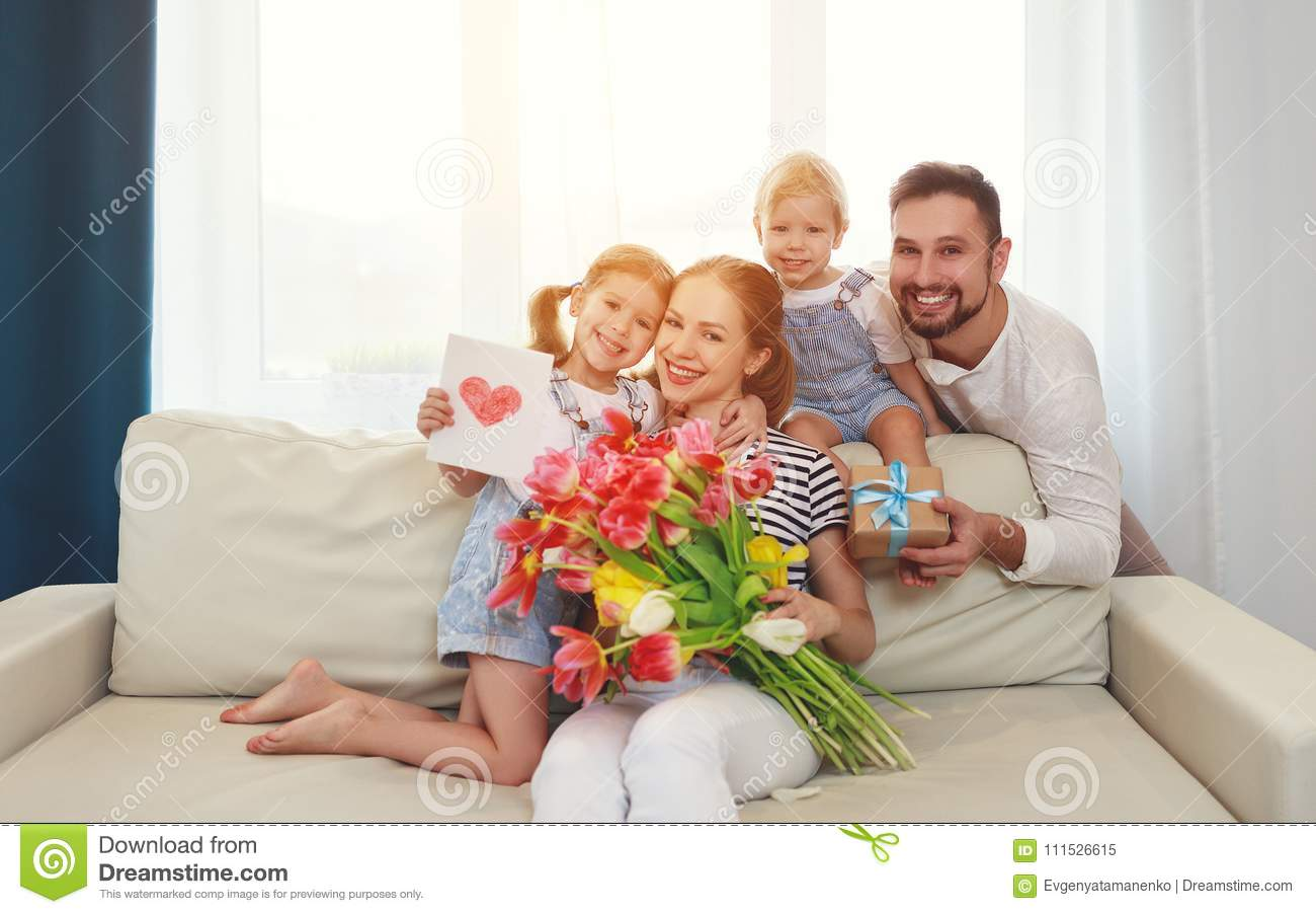 Happy mother`s day! father and children congratulate mother on h