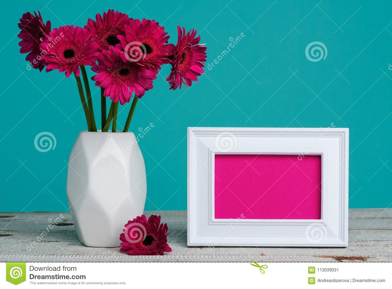 Happy Mother`s Day, Women`s Day, Valentine`s Day or Birthday Pastel Candy Blue Coloured Background. Dark pink gerberas in a vase.