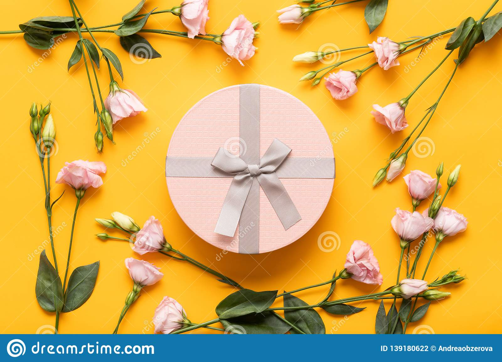 Happy Mother`s Day, Women`s Day, Valentine`s Day or Birthday Yellow and Pastel Pink Colored Background. Flat lay greeting card.