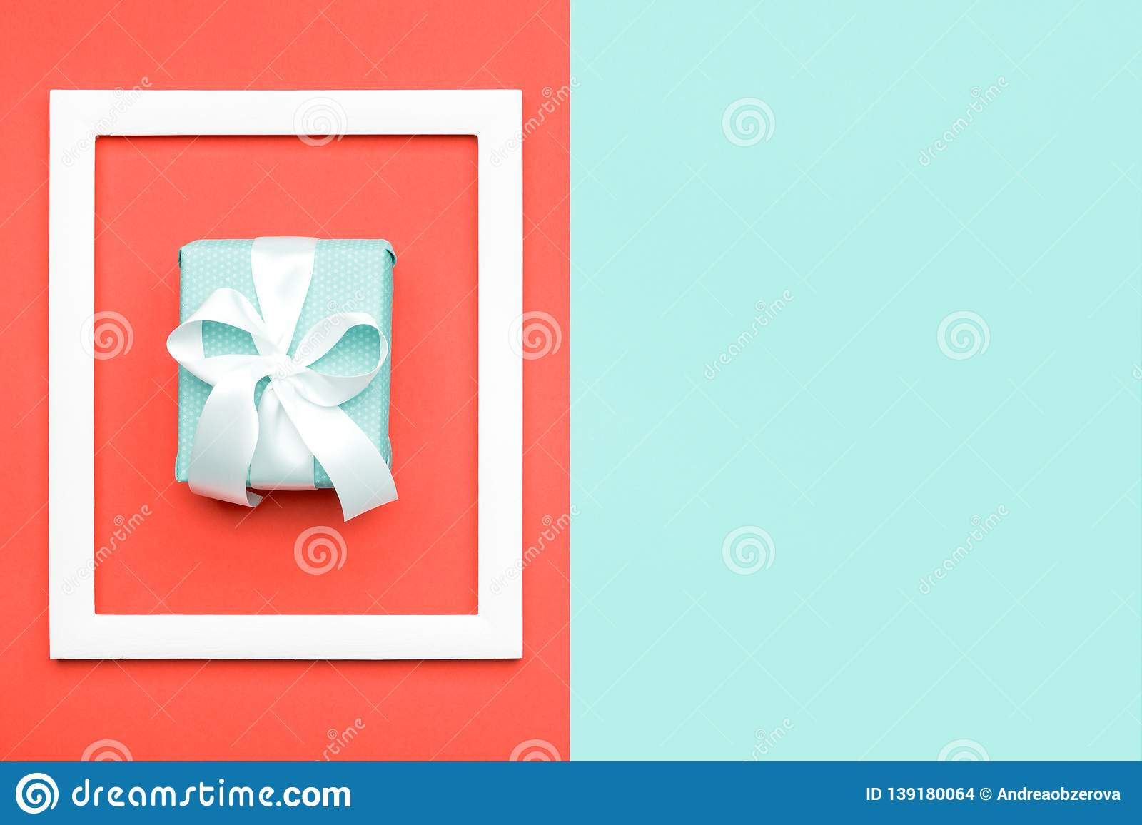 Happy Mother`s Day, Women`s Day, Valentine`s Day or Birthday Living Coral Background. Flat lay minimal greeting card with gift box