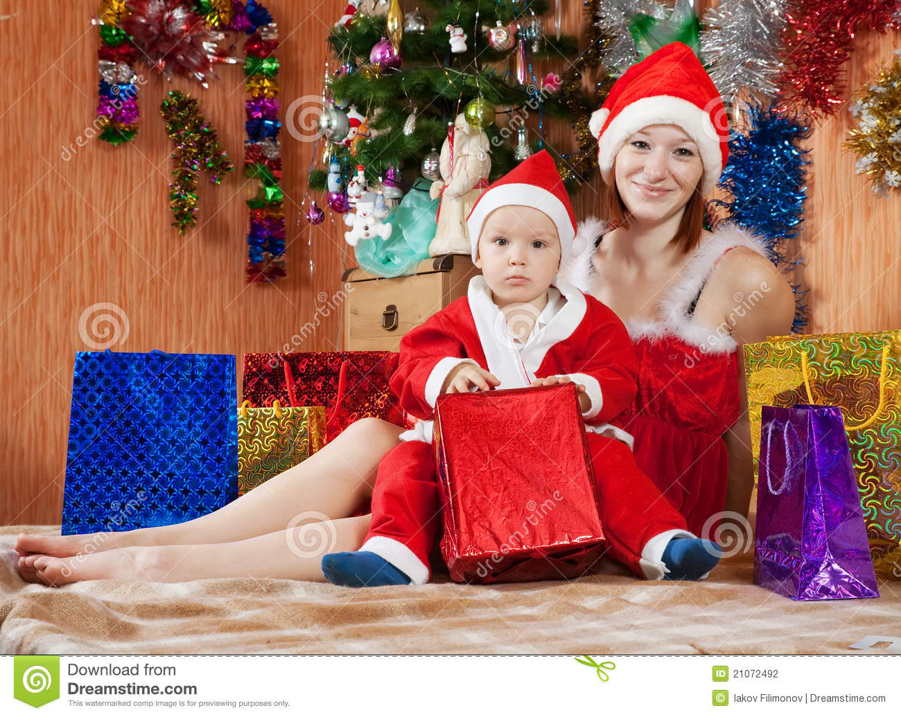 Happy Mother And Son With Christmas Gifts Stock Photo