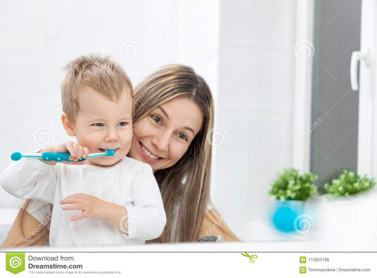 Happy Mother Teaching Her Son How To Bush Teeth Stock ...