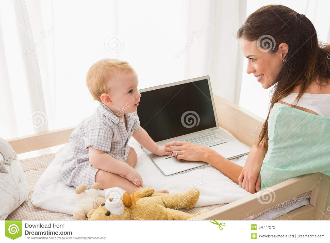 Mother And Baby At Home Using Laptop Computer Royalty-Free ...