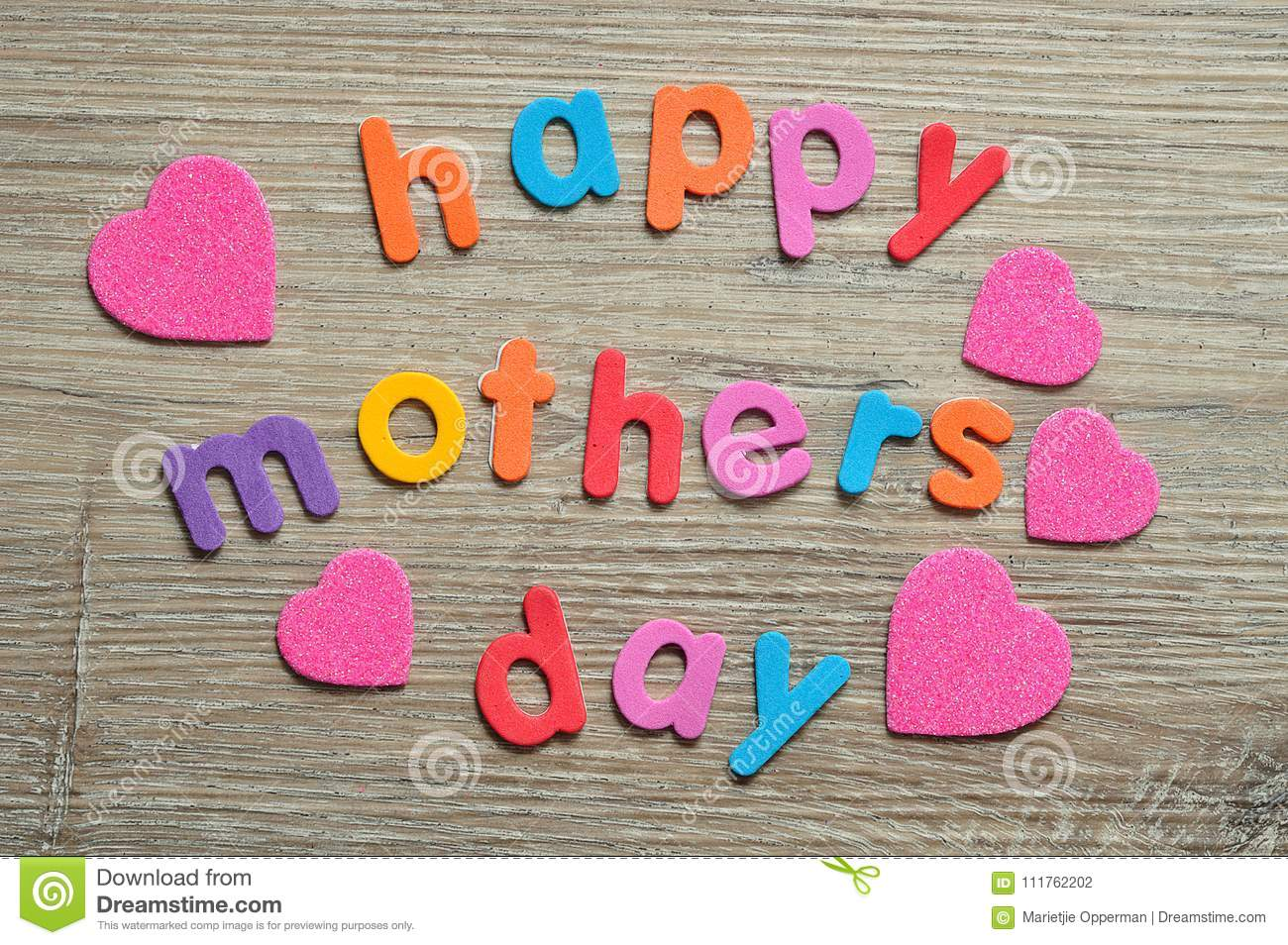 Happy mothers day in colorful letters with pink hearts