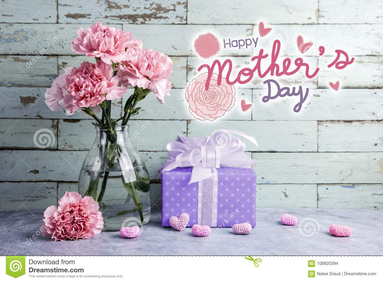 Happy mothers day message on wood background and pink carnation