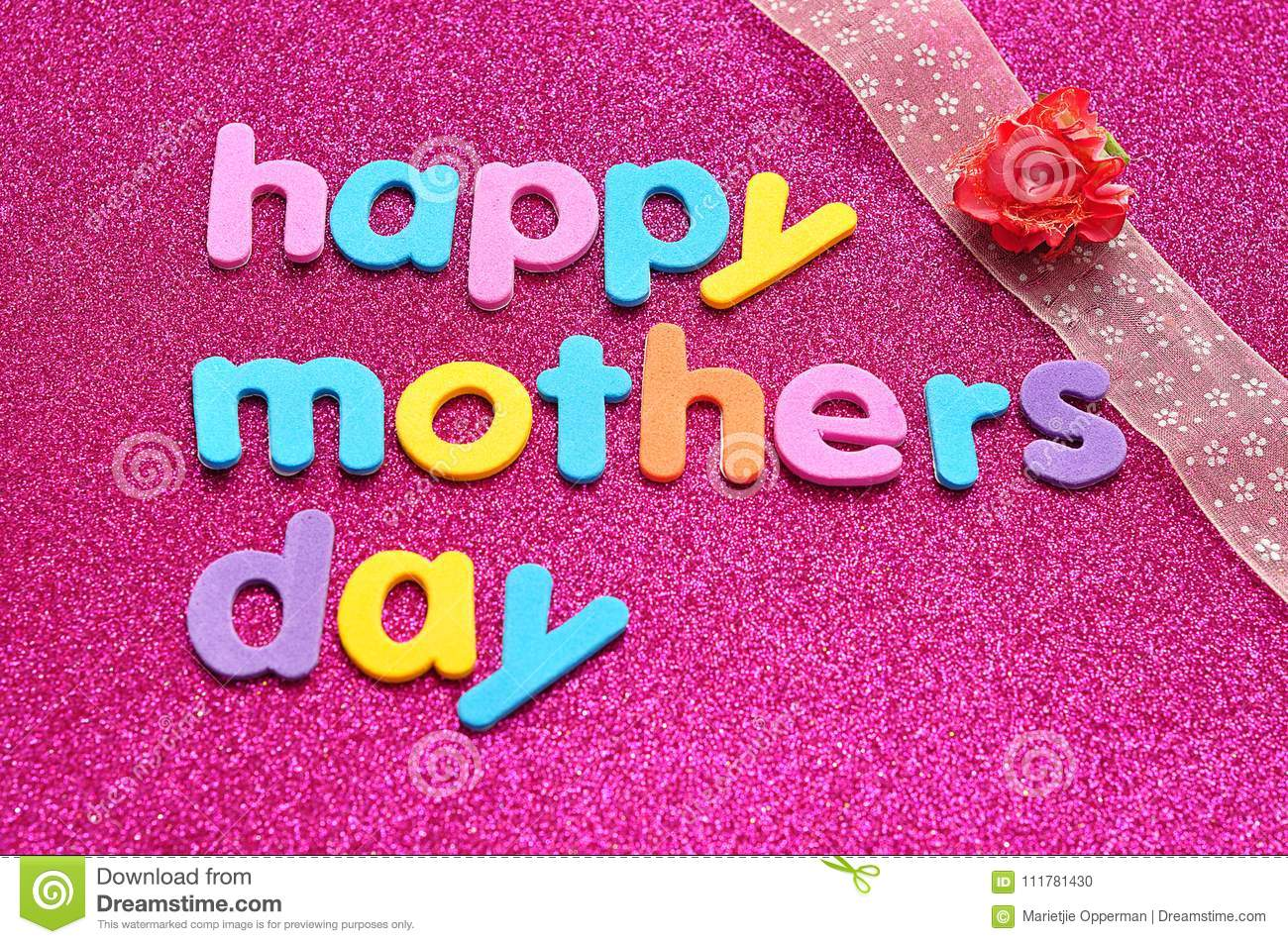 Happy mothers day on a pink background with a pink ribbon and an artificial rose