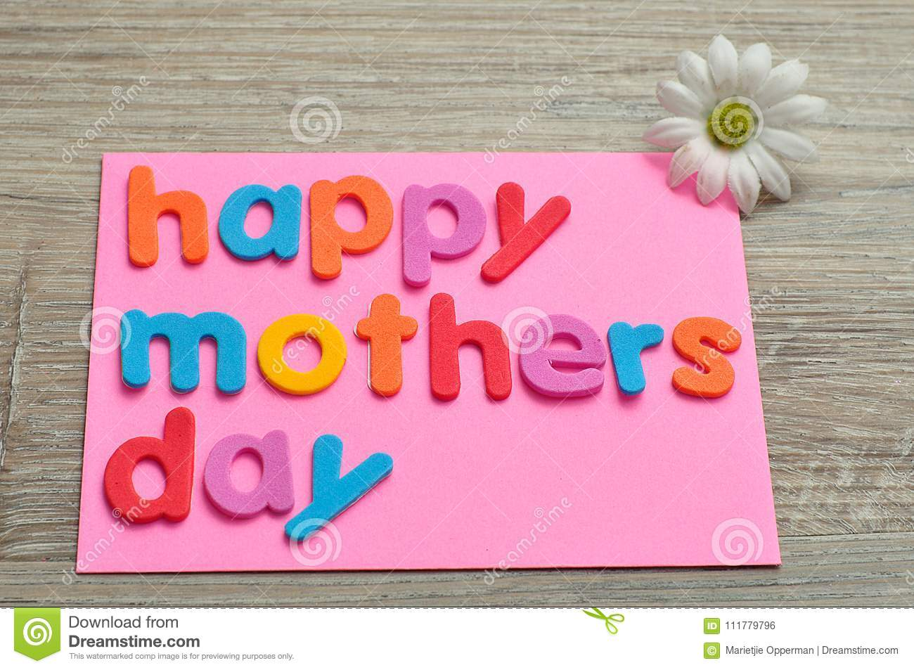 Happy mothers day on a pink note with a white daisy
