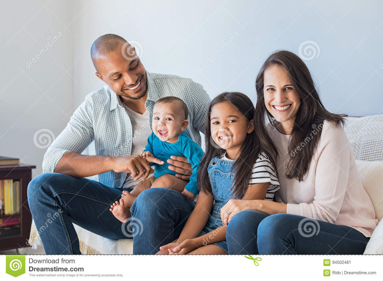 Happy multiethnic family on sofa