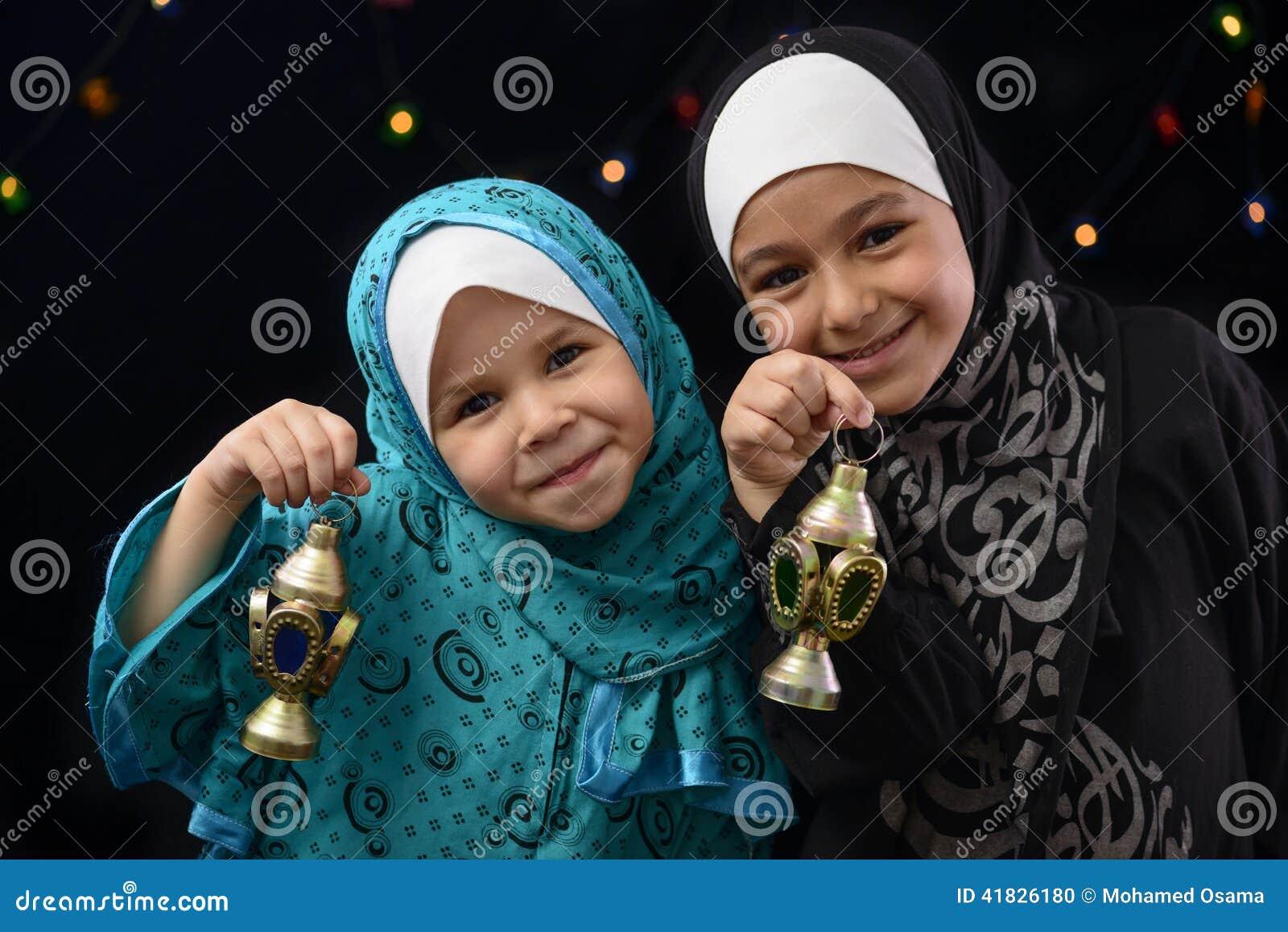 Happy Muslim Girls with Ramadan Lantern