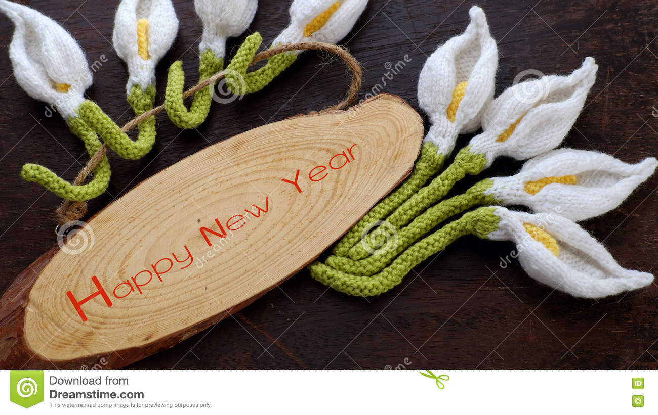 amazing happy new year background from wood banner with nine of handmade white arum lily knit from yarn diy home decor to make new year ornament in spring