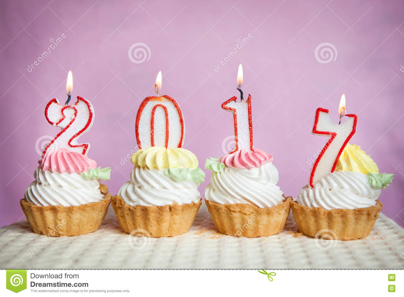 happy new 2017 year with candles on cakes with pink background stock photo 77990383 megapixl