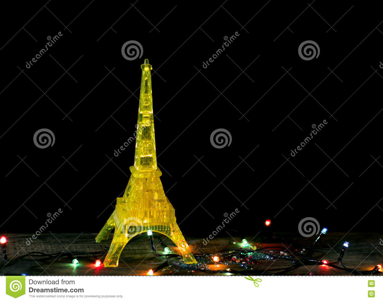 happy new year card with gold yellow model of the eiffel tower in paris