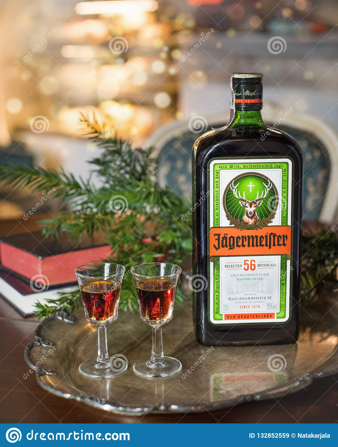Happy new year or christmas background with Jagermeister alcohol drink, elixir. Bottle of Jagermeister with glasses on a vintage t