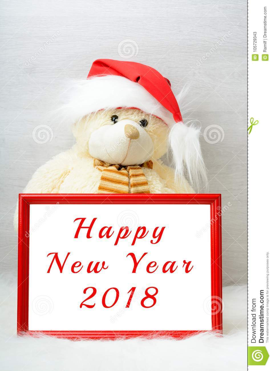 happy new year 2018 card with a cute teddy bear wearing a santa claus hat in snow