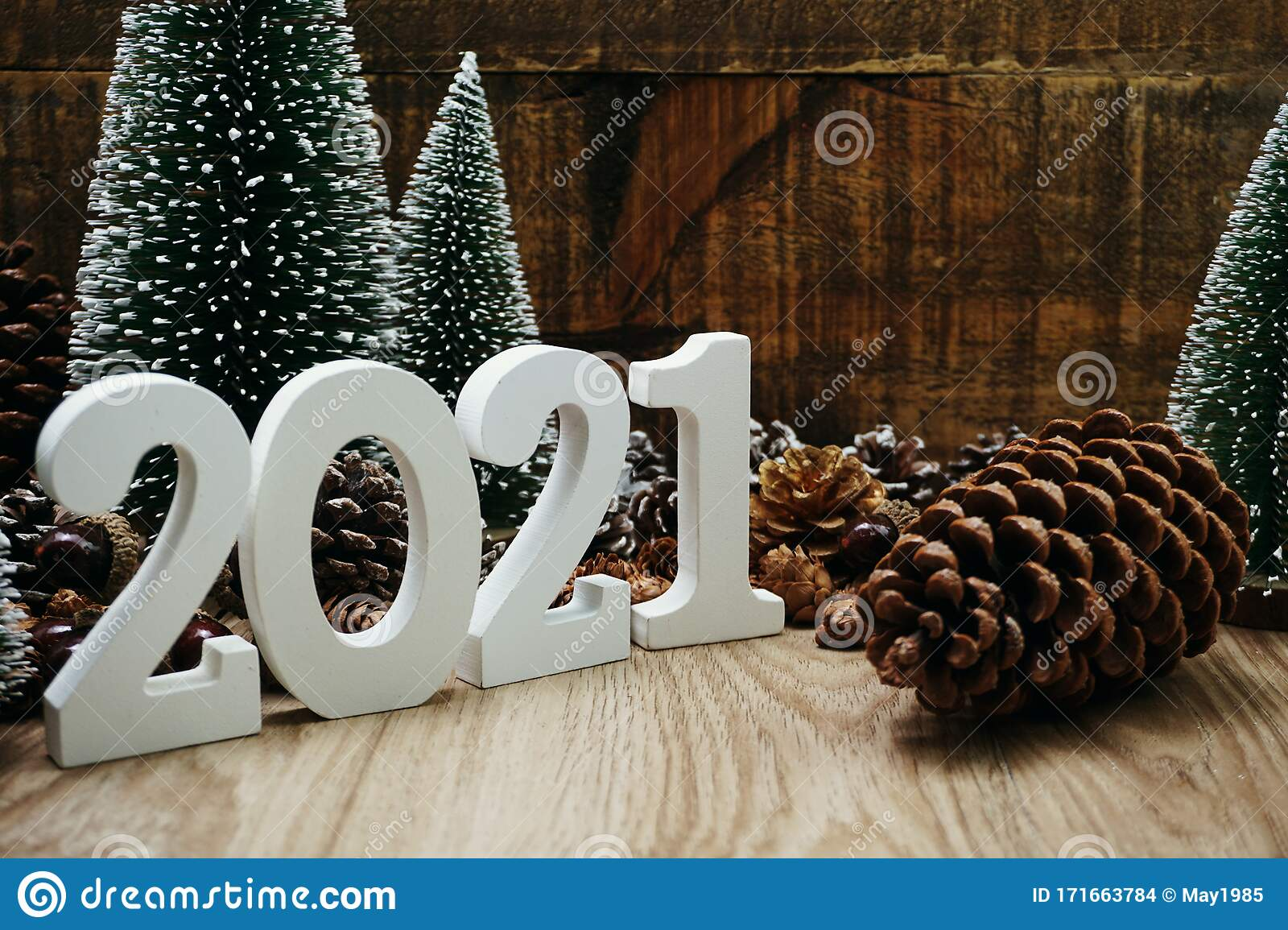 Christmas Tree Recolection 2021 2021 Happy New Year Festive Background With Christmas Tree And Pine Cone Decoration On Wooden Background Stock Photo Image Of Design Decoration 171663784